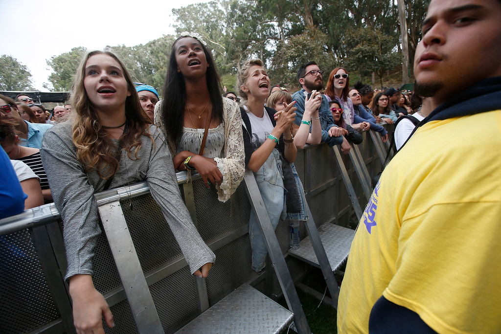 . Fans watch Jenny Lewis perform as security keeps a watchful eye on the Sutro stage during day three of the Outside Lands music festival at Golden Gate Park in San Francisco, Calif., on Sunday, Aug. 10, 2014. (Jane Tyska/Bay Area News Group)