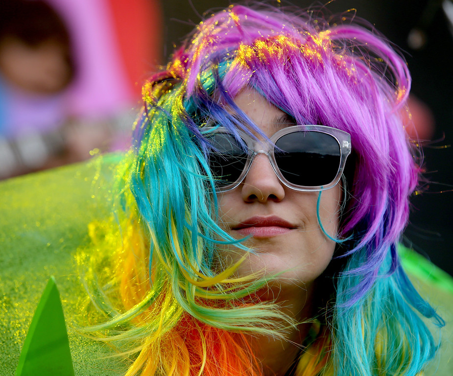 . A fan becomes part of the act as The Flaming Lips perform on the Land\'s End stage during day three of the Outside Lands music festival at Golden Gate Park in San Francisco, Calif., on Sunday, Aug. 10, 2014. (Jane Tyska/Bay Area News Group)