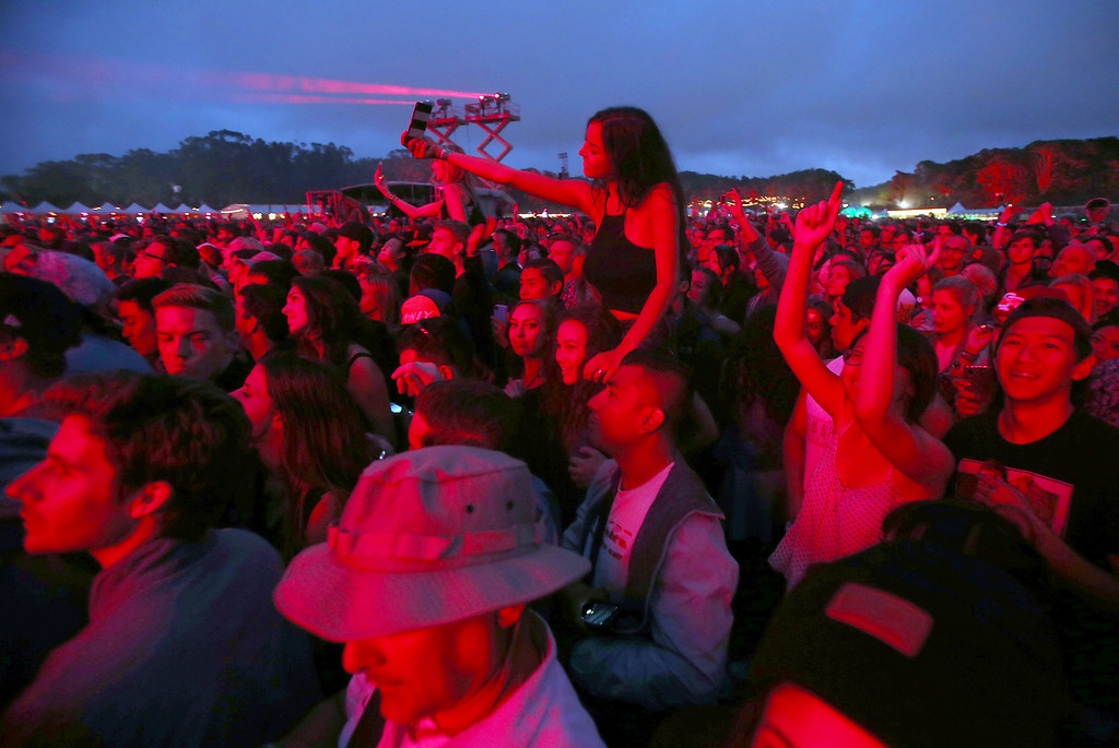 . A large crowd listens The Killers perform on the Land\'s End stage during day three of the Outside Lands music festival at Golden Gate Park in San Francisco, Calif., on Sunday, Aug. 10, 2014. (Jane Tyska/Bay Area News Group)