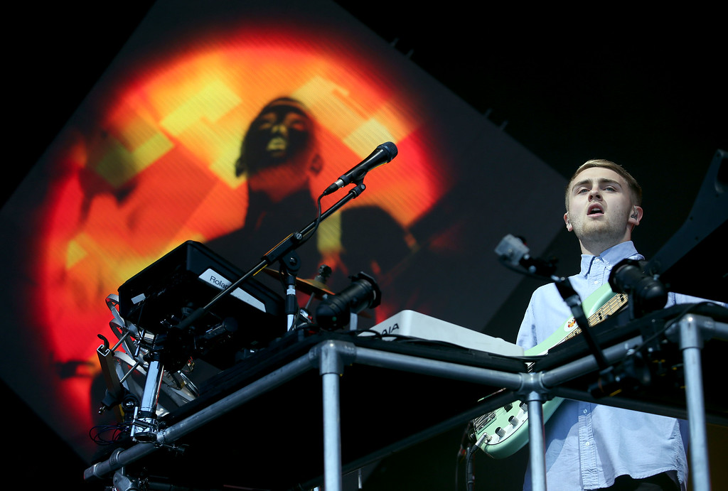 . Howard Lawrence, of Disclosure, plays bass as they perform on the Land\'s End stage during day one of the Outside Lands music festival at Golden Gate Park in San Francisco, Calif., on Friday, Aug. 8, 2014. His brother Guy Lawrence is the other half of the electronic music duo. (Jane Tyska/Bay Area News Group)