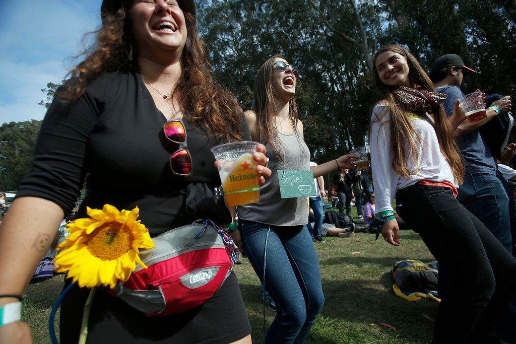 . Lani Mednick, Gina Giarmo and Catherine O\'Hare, all of Berkeley, dance as they listen to music on the Sutro stage during day one of the Outside Lands music festival at Golden Gate Park in San Francisco, Calif., on Friday, Aug. 8, 2014. (Jane Tyska/Bay Area News Group)