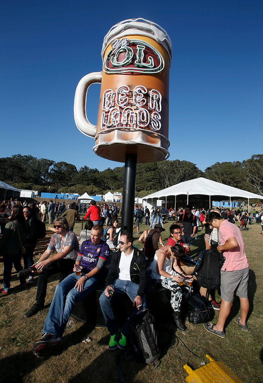 . Crowds gather near the beer lands sign on day one of the Outside Lands music festival at Golden Gate Park in San Francisco, Calif., on Friday, Aug. 8, 2014. (Jane Tyska/Bay Area News Group)