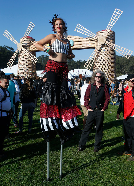 . Jamie Thompson, of Santa Cruz\'s Samba Stilt Circus, walks through the crowd in Marx Meadow during day one of the Outside Lands music festival at Golden Gate Park in San Francisco, Calif., on Friday, Aug. 8, 2014. Kanye West was the headliner among the many bands who performed on Friday. The festival runs through Sunday, Aug. 10. (Jane Tyska/Bay Area News Group)
