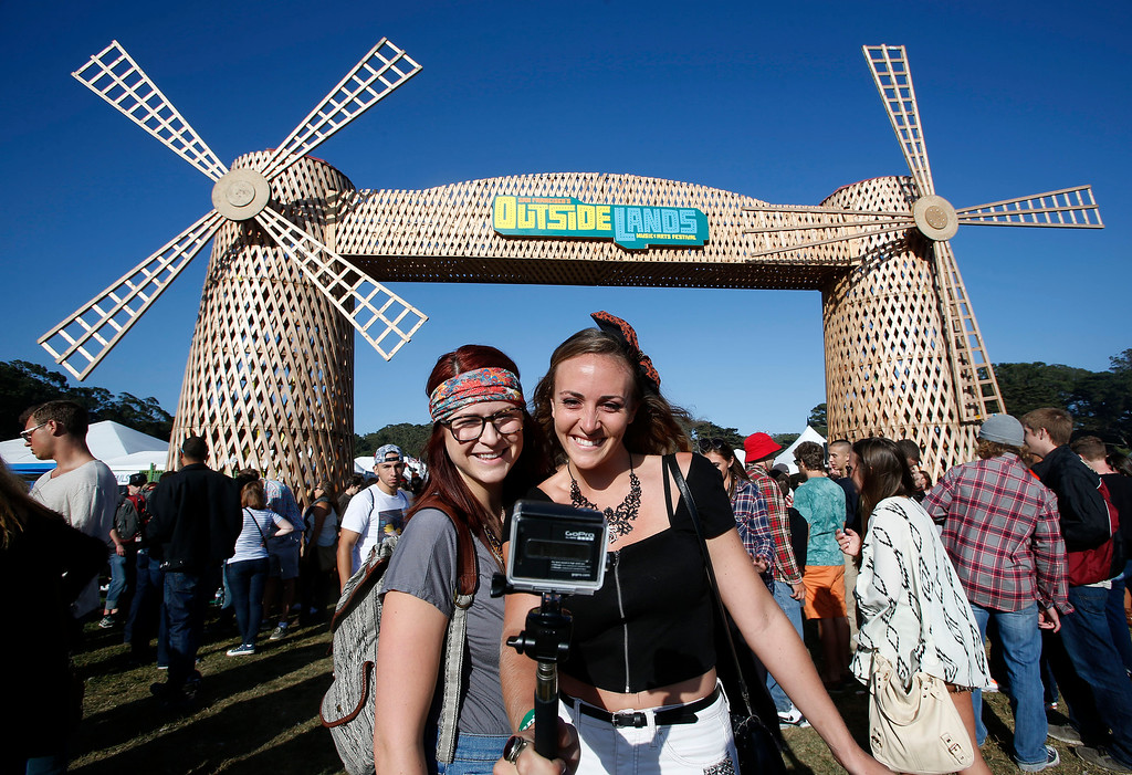 . Claire Fabrocini, left, and Kim Horst, of Los Angeles, take a selfie with their GoPro camera during the Outside Lands music festival at Golden Gate Park in San Francisco, Calif., on Friday, Aug. 8, 2014. (Jane Tyska/Bay Area News Group)