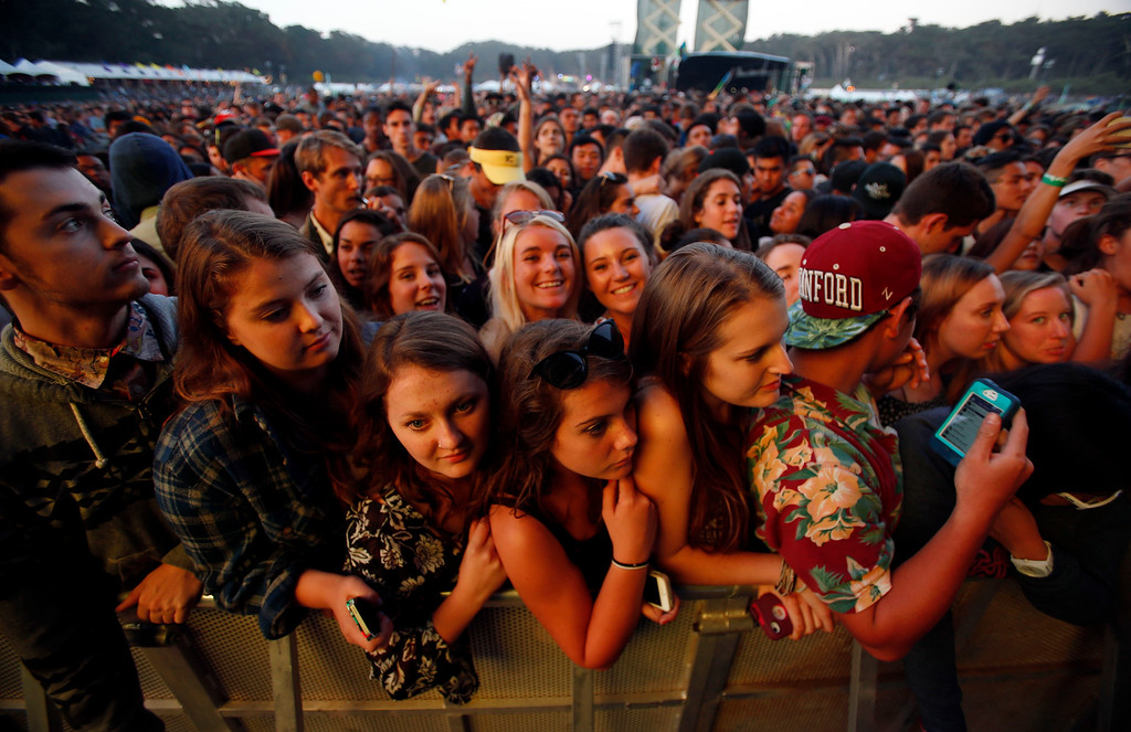 . Crowds wait for Kanye West to take the Land\'s End stage during day one of the Outside Lands music festival at Golden Gate Park in San Francisco, Calif., on Friday, Aug. 8, 2014. (Jane Tyska/Bay Area News Group)