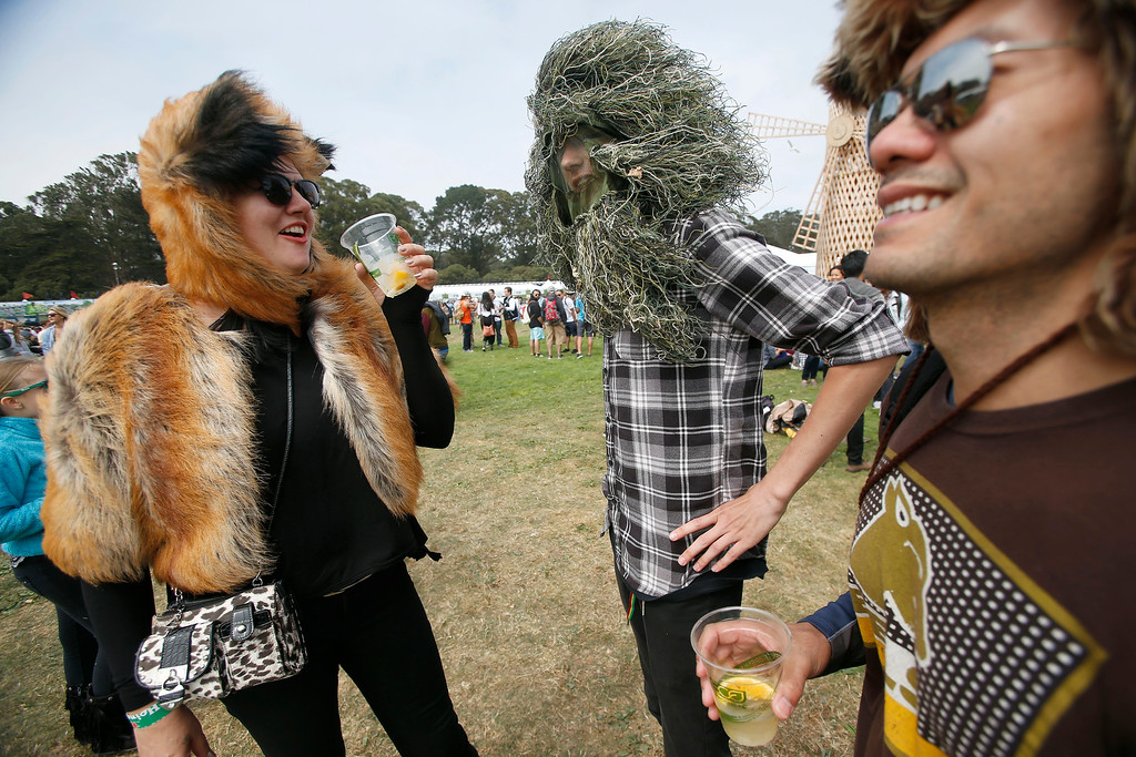 . **CQ** Rochelle Daly-Baird, Evn Daly and Joel Antipuesto, left to right, all of San Francisco, hang out during day one of the Outside Lands music festival at Golden Gate Park in San Francisco, Calif., on Friday, Aug. 8, 2014. (Jane Tyska/Bay Area News Group)