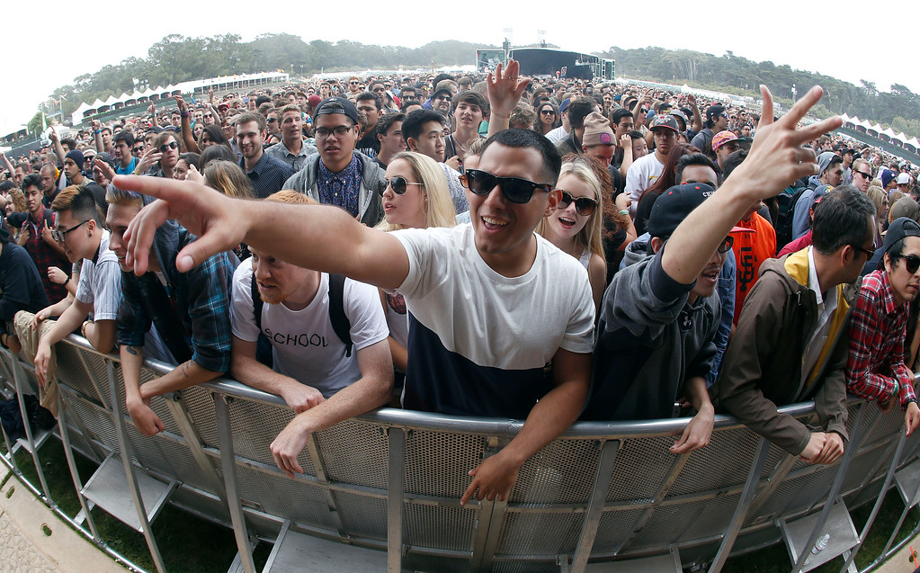 . Chris Huerta, of Pasadena, center, and others belly up to the pit during day one of the Outside Lands music festival at Golden Gate Park in San Francisco, Calif., on Friday, Aug. 8, 2014. (Jane Tyska/Bay Area News Group)