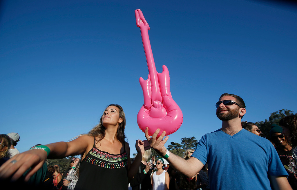 . Natan Ovadia, and Lexi Lex, left, of San Francisco, listen to bands on the Land\'s End stage during day one of the Outside Lands music festival at Golden Gate Park in San Francisco, Calif., on Friday, Aug. 8, 2014. (Jane Tyska/Bay Area News Group)