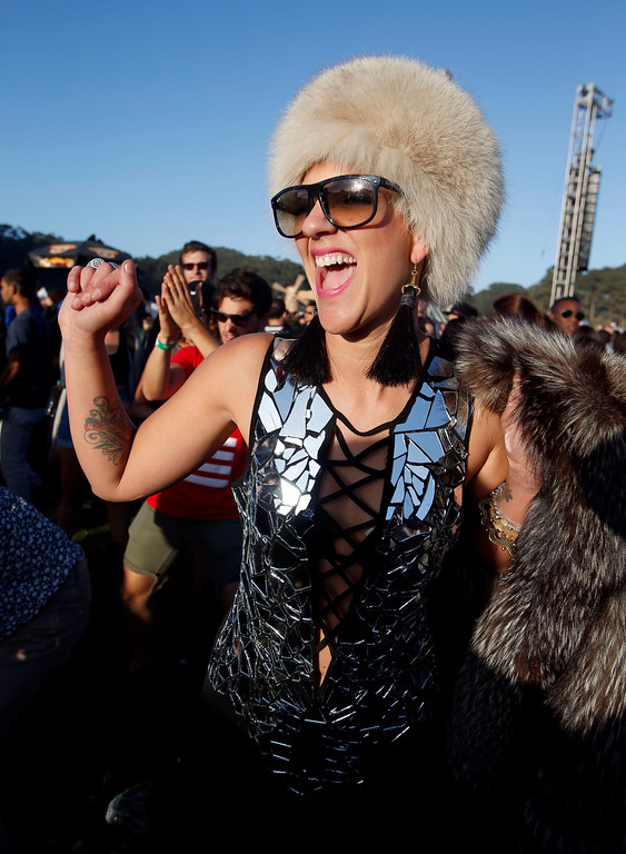 . Sylvia Simon, of San Francisco, dances near the Land\'s End stage on day one of the Outside Lands music festival at Golden Gate Park in San Francisco, Calif., on Friday, Aug. 8, 2014. (Jane Tyska/Bay Area News Group)
