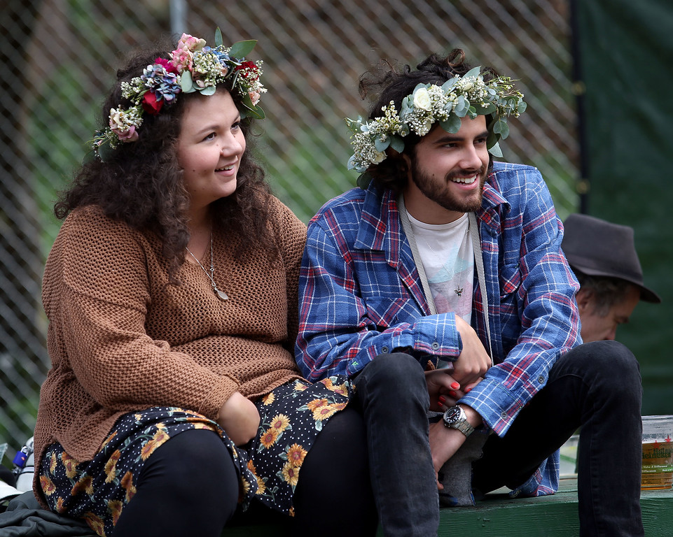 . Matti McKenzie and Ben Schilling, of Placerville, watch bands at the Sutro stage during day one of the Outside Lands music festival at Golden Gate Park in San Francisco, Calif., on Friday, Aug. 8, 2014. (Jane Tyska/Bay Area News Group)