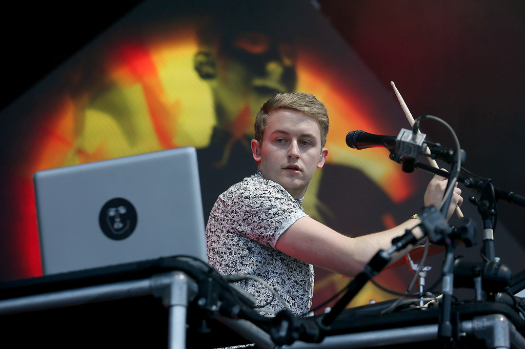 . Guy Lawrence, of Disclosure, performs on the Land\'s End stage during day one of the Outside Lands music festival at Golden Gate Park in San Francisco, Calif., on Friday, Aug. 8, 2014. His brother Howard Lawrence is the other half of the electronic music duo. (Jane Tyska/Bay Area News Group)