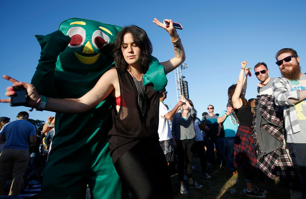 . Daniela Howard, of San Francisco, dances with a man dressed as Gumby during day one of the Outside Lands music festival at Golden Gate Park in San Francisco, Calif., on Friday, Aug. 8, 2014. (Jane Tyska/Bay Area News Group)