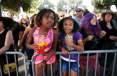 Lauren Payton, 9, of Illinois, at left, and Maliyah Mcod-Black , 8, of Fairfield, listen to Tony Lindsay and The Soul Soldiers during the San Jose Jazz Festival at the Plaza de César Chavez in San Jose, Calif., on Friday, Aug. 12, 2016. (Jim Gensheimer/Bay Area News Group)