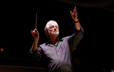 "David Rohrbaugh conducts the orchestra during a dress rehearsal of Puccini's ""Madama Butterfly"" at the California Theatre in San Jose, Calif. on Wednesday, Feb. 12, 2014. (Gary Reyes/Bay Area News Group)"