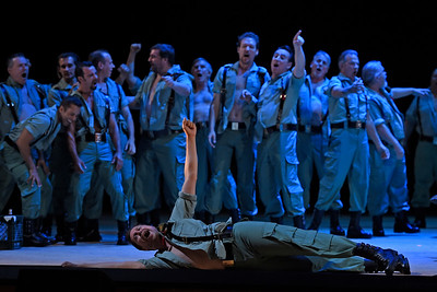 Pride — and drunken revelry — comes before a fall.  Men of the San Francisco Opera Chorus play the carousing soldiers to the hilt. (Jose Carlos Fajardo/Bay Area News Group)