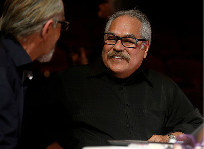 Luis Valdez talks to staffers about future events while at the San Jose Stage Company in San Jose, Calif., on Monday, Oct. 19, 2015. Valdez founded El Teatro Campesino, the famed Farmworkers Theater, on the picket lines of the 1965 Grape Boycott led by Cesar Chavez. Now Valdez, an SJSU alum who staged his first play on campus, is celebrating the landmark 50th anniversary of the legendary troupe at its home base in San Juan Bautista as well as preparing for a new play at San Jose Stage. (Nhat V. Meyer/Bay Area News Group)