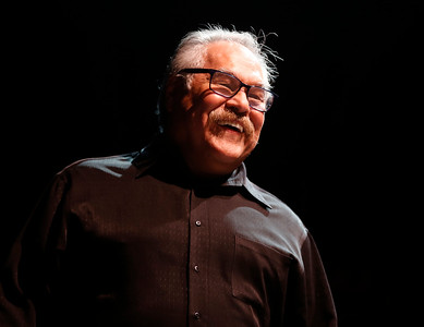 Luis Valdez smiles as he talks to staffers about future events while at the San Jose Stage Company in San Jose, Calif., on Monday, Oct. 19, 2015. Valdez founded El Teatro Campesino, the famed Farmworkers Theater, on the picket lines of the 1965 Grape Boycott led by Cesar Chavez. Now Valdez, an SJSU alum who staged his first play on campus, is celebrating the landmark 50th anniversary of the legendary troupe at its home base in San Juan Bautista as well as preparing for a new play at San Jose Stage. (Nhat V. Meyer/Bay Area News Group)