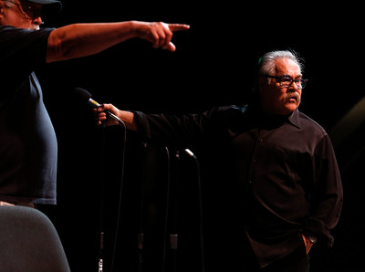 Luis Valdez, right, talks to staffers, including Phil Esparza, left, about future events while at the San Jose Stage Company in San Jose, Calif., on Monday, Oct. 19, 2015. Valdez founded El Teatro Campesino, the famed Farmworkers Theater, on the picket lines of the 1965 Grape Boycott led by Cesar Chavez. Now Valdez, an SJSU alum who staged his first play on campus, is celebrating the landmark 50th anniversary of the legendary troupe at its home base in San Juan Bautista as well as preparing for a new play at San Jose Stage. (Nhat V. Meyer/Bay Area News Group)