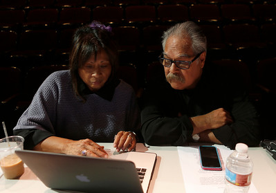 Luis Valdez, right, and Marilyn Abad-Cardinalli look at an audition tape for a future play while at the San Jose Stage Company in San Jose, Calif., on Monday, Oct. 19, 2015. Valdez founded El Teatro Campesino, the famed Farmworkers Theater, on the picket lines of the 1965 Grape Boycott led by Cesar Chavez. Now Valdez, an SJSU alum who staged his first play on campus, is celebrating the landmark 50th anniversary of the legendary troupe at its home base in San Juan Bautista as well as preparing for a new play at San Jose Stage. (Nhat V. Meyer/Bay Area News Group)
