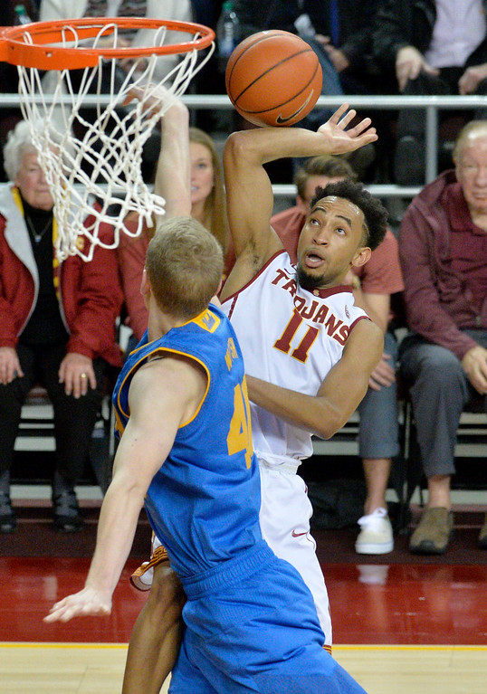 . USC�s  Jordan McLaughlin(11) gets fouled by UCLA�s Thomas Welsh(40) under the basket during a basketball rivalry showdown in Los Angeles Wednesday, January 25, 2017. (Photo by Thomas R. Cordova, Daily News/SCNG)