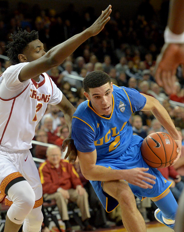 . UCLA�s Lonzo Ball(2) tries to get around USC�s Jonah Mathews(2) during a basketball rivalry showdown in Los Angeles Wednesday, January 25, 2017. (Photo by Thomas R. Cordova, Daily News/SCNG)