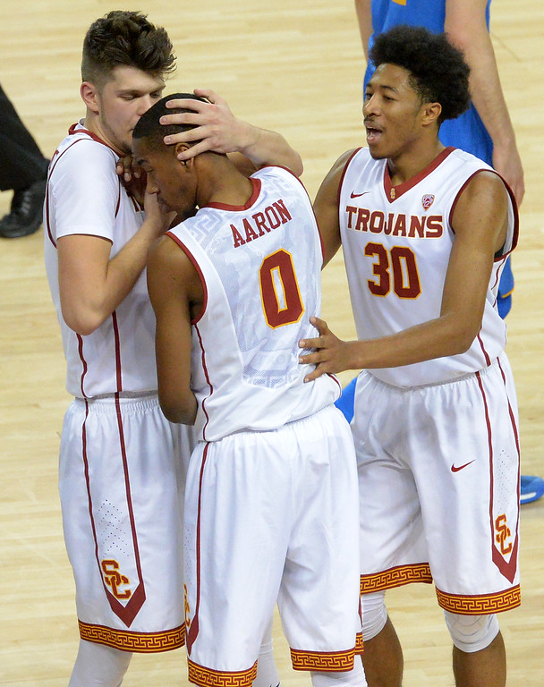 . USC�s Nick Rakocevic(31) left, embraces  Shaqquan Aaron(0), center with Elijah Stewart(30) right, near by after a win over UCLA in a  basketball rivalry showdown in Los Angeles Wednesday, January 25, 2017. (Photo by Thomas R. Cordova, Daily News/SCNG)