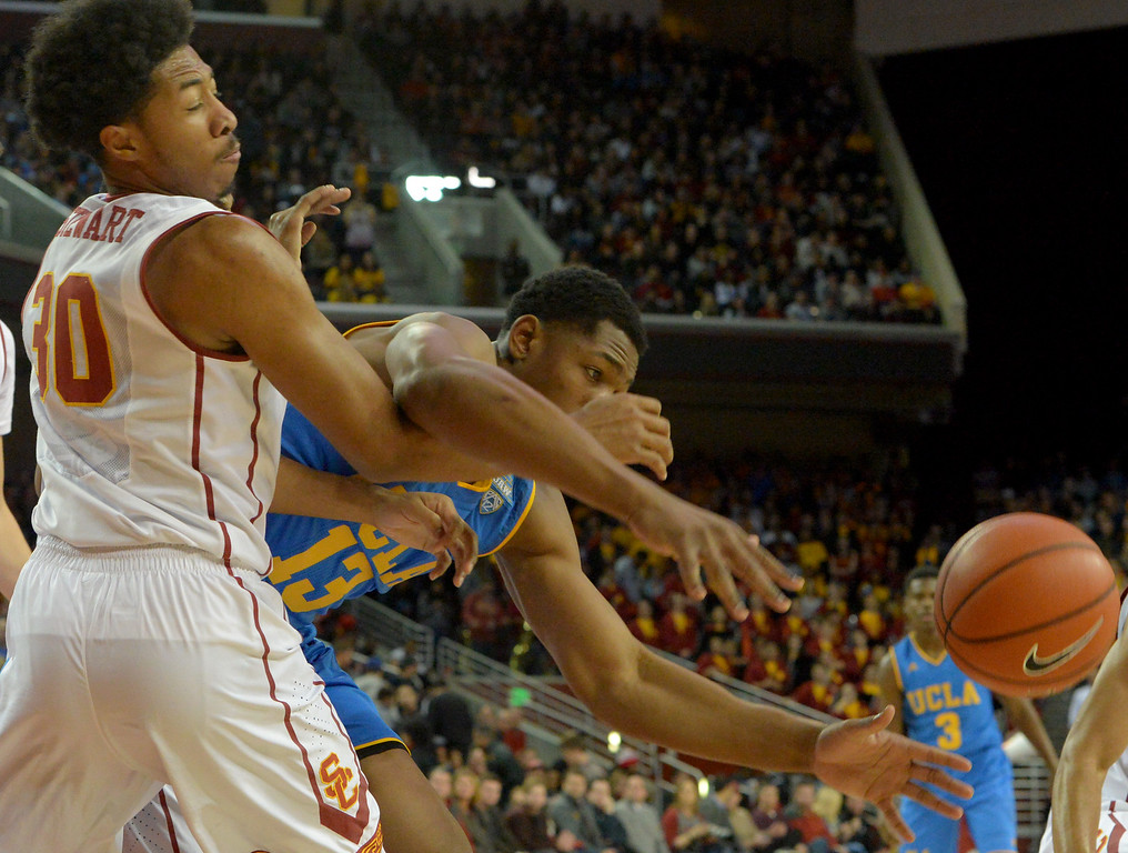 . UCLA�s Ike Anigbogu(13) goes after a rebound against USC�s Elijah Stewart(30) during a basketball rivalry showdown in Los Angeles Wednesday, January 25, 2017. (Photo by Thomas R. Cordova, Daily News/SCNG)