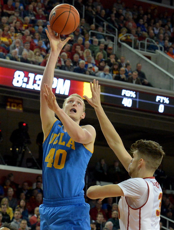 . UCLA�s Thomas Welsh(40)shoots for the basket over USC�s Nick Rakocevic(31) during a basketball rivalry showdown in Los Angeles Wednesday, January 25, 2017. (Photo by Thomas R. Cordova, Daily News/SCNG)