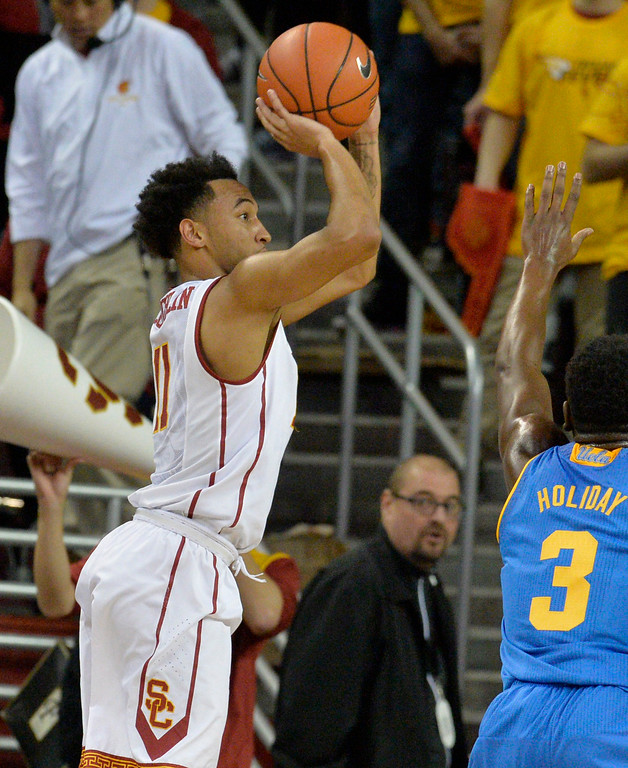 . USC�s Jordan McLaughlin(11) shoots from the outside against UCLA basketball rivalry showdown in Los Angeles Wednesday, January 25, 2017. (Photo by Thomas R. Cordova, Daily News/SCNG)
