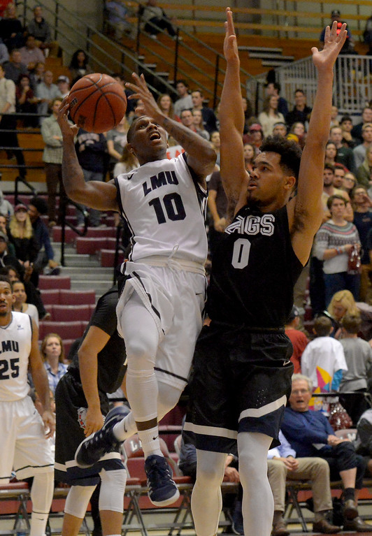 . Loyola Marymount�s Brandon Brown(10) drives the ball to the basket against Gonzaga�s Silas Melson(0) in a West Coast Conference game in Los Angeles Thursday, February 9, 2017. (Photo by Thomas R. Cordova, Daily News/SCNG)