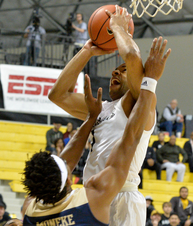 . Long Beach State�s Evan Payne(1) gets under the basket against UC Davis Chima Moneke(11) in a Big West NCAA Men\'s Basketball game in Long Beach Thursday, February 16, 2017.  (Photo by Thomas R. Cordova, Press-Telegram/SCNG)