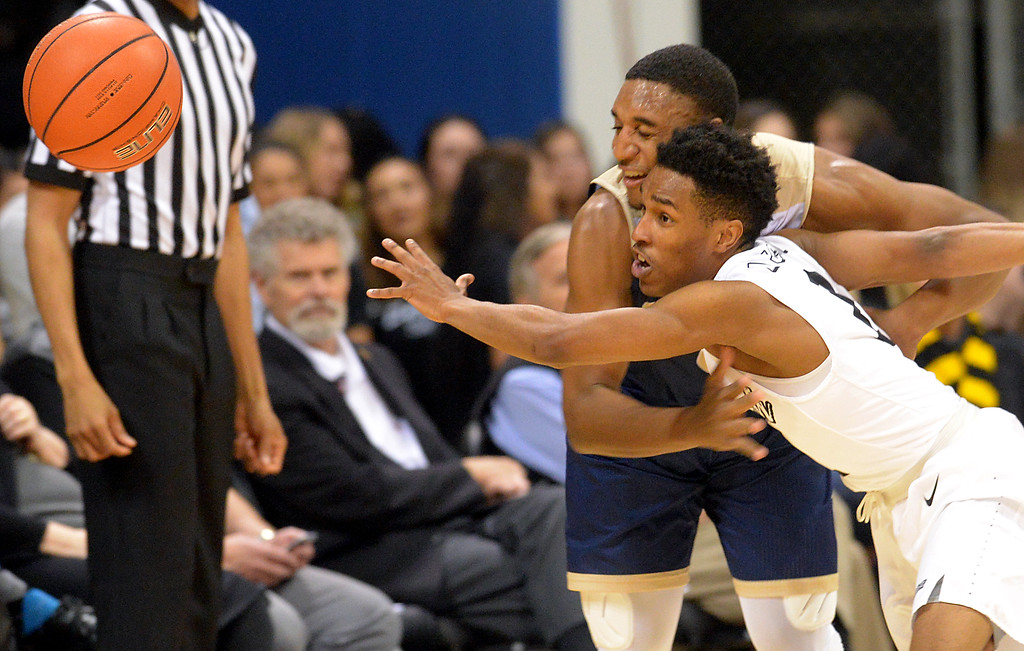 . Long Beach State�s LorenJackson(2) battles for the ball with UC Davis Brynton Lemar(0) in a Big West NCAA Men\'s Basketball game in Long Beach Thursday, February 16, 2017.  (Photo by Thomas R. Cordova, Press-Telegram/SCNG)
