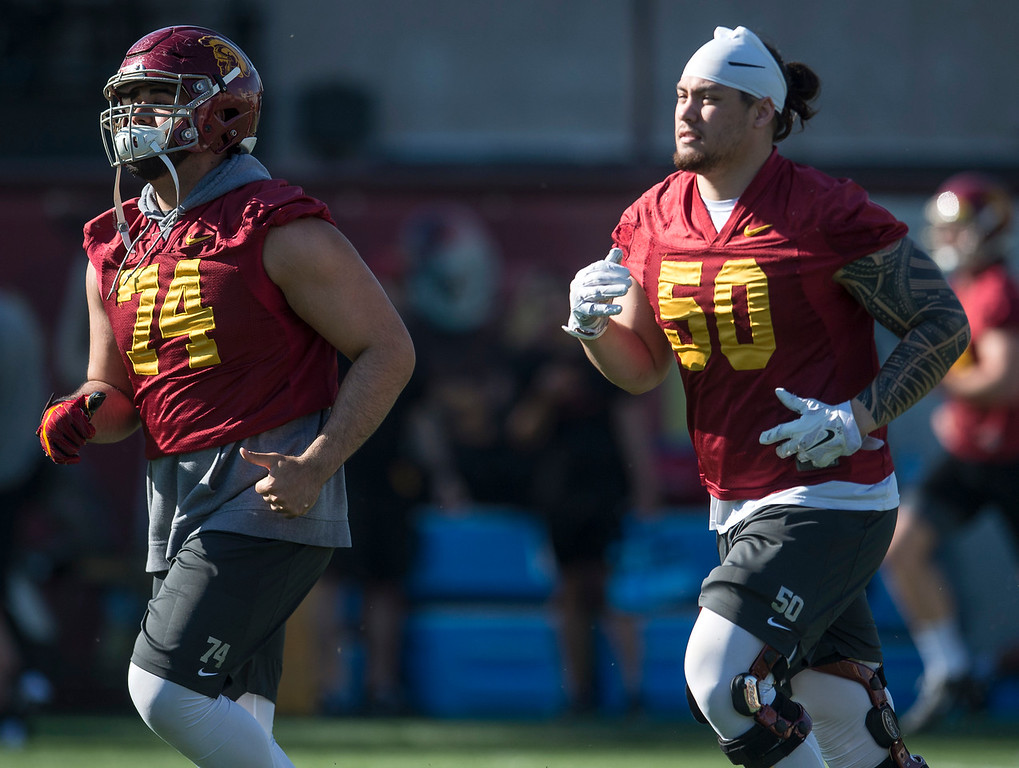 . Nico Falah, left, and Toa Lobendahn run across the field during USC�s spring football practice at Howard Jones Field/Brian Kennedy Field in Los Angeles on Thursday, March 09, 2017. (Photo by Ed Crisostomo, Los Angeles Daily News/SCNG)