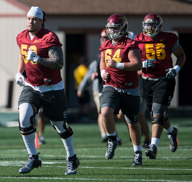 . Toa Lobendahn, left, runs across the field during USC�s spring football practice at Howard Jones Field/Brian Kennedy Field in Los Angeles on Thursday, March 09, 2017. (Photo by Ed Crisostomo, Los Angeles Daily News/SCNG)
