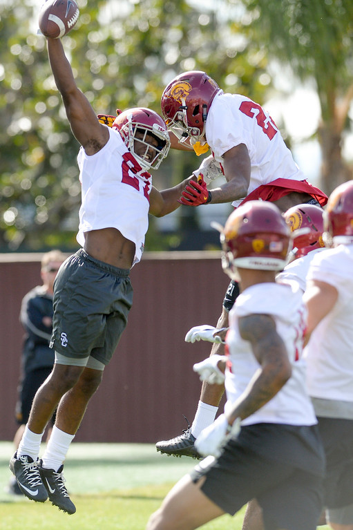 . USC\'s Ajene Harris, #27, and Jamel Cook, #21, celebrate a final play during spring practice at USC Thursday, April 13, 2017.  ( Photo by David Crane, Los Angeles Daily News/SCNG)