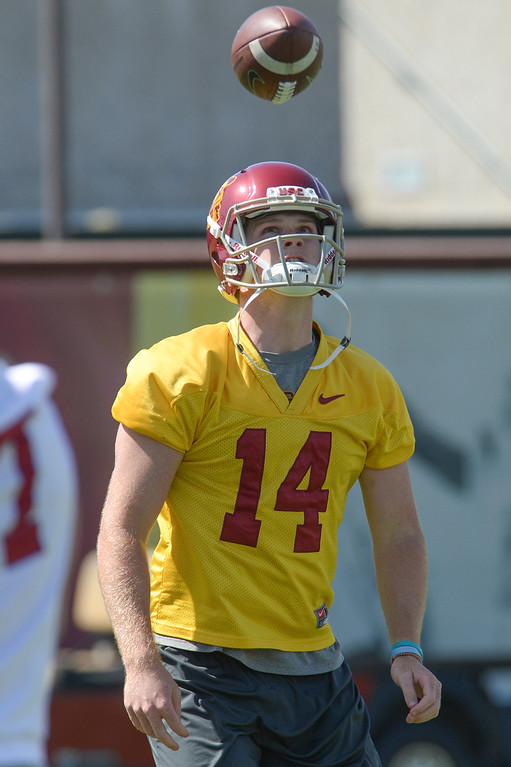 . USC\'s QB Sam Darnold, #14, bounces a football off of his helmet before the start of spring practice at USC Thursday, April 13, 2017.  ( Photo by David Crane, Los Angeles Daily News/SCNG)