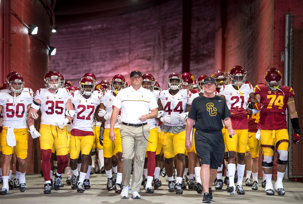 . Head coach Clay Helton, center, leads his team onto the field during USC Spring Game at the Los Angeles Memorial Coliseum in Los Angeles on Saturday, April 15, 2017. (Photo by Ed Crisostomo, Los Angeles Daily News/SCNG)