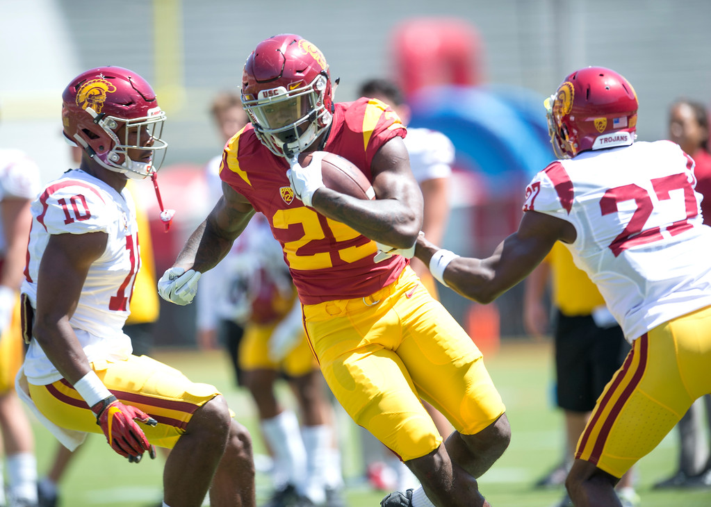 . Tailback Ronald Jones II shows his moves against John Houston Jr., left, and Ajene Harris during USC Spring Game at the Los Angeles Memorial Coliseum in Los Angeles on Saturday, April 15, 2017. (Photo by Ed Crisostomo, Los Angeles Daily News/SCNG)