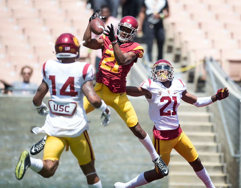. Wide receiver Tyler Vaughns, goes high for the ball in the end zone against safety Jamel Cook, right, and Ykili Ross during USC Spring Game at the Los Angeles Memorial Coliseum in Los Angeles on Saturday, April 15, 2017. (Photo by Ed Crisostomo, Los Angeles Daily News/SCNG)