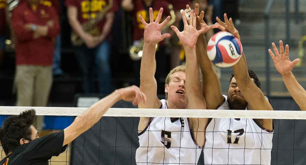 . Long Beach State�s Kyle Ensing(5) and Amir Lugo-Rodriguez(17) blocks USC�s Lucas Lossone(22) ball during the MPSF Tournament NCAA Men\'s Volleyball in Long Beach Saturday, April 15, 2017.  (Photo by Thomas R. Cordova, Press-Telegram/SCNG)