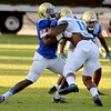 UCLA's Takkarist McKinley, left, defends teammate Nate Iese during football practice on Wednesday, August 17, 2016 at California State University San Bernardino in San Bernardino, Ca. (Micah Escamilla/The Sun, SCNG)
