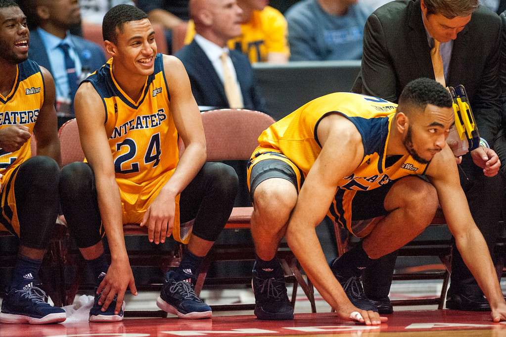 . UC Irvine guard Eyassu Worku, center, and forward Jonathan Galloway watch as the Anteaters try to score against UC Davis late in the second half during the Big West Tournament Championship game  in Anaheim on Saturday, March 11, 2017. (Photo by Paul Rodriguez, Orange County Register/SCNG)