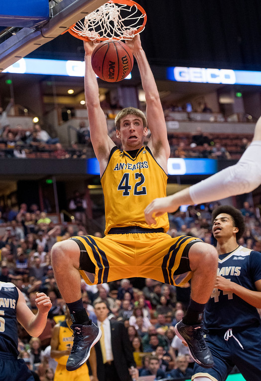 . UC Irvine forward Tommy Rutherford slams the ball late in the second half against UC Davis during the Big West Tournament Championship game in Anaheim on Saturday, March 11, 2017. (Photo by Paul Rodriguez, Orange County Register/SCNG)