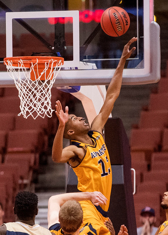 . UC Irvine forward Brandon Smith blocks a shot by UC Davis with seconds left on the clock in the Big West Tournament Championship game in Anaheim on Saturday, March 11, 2017. (Photo by Paul Rodriguez, Orange County Register/SCNG)