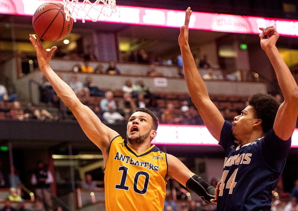 . UC Irvine guard Luke Nelson, left, goes around UC Davis forward Garrison Goode for the basket during the Big West Tournament Championship game in Anaheim on Saturday, March 11, 2017. (Photo by Paul Rodriguez, Orange County Register/SCNG)