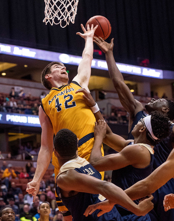 . UC Irvine forward Tommy Rutherford, left, tries to reach a rebound during the Big West Tournament Championship game against UC Davis in Anaheim on Saturday, March 11, 2017. (Photo by Paul Rodriguez, Orange County Register/SCNG)