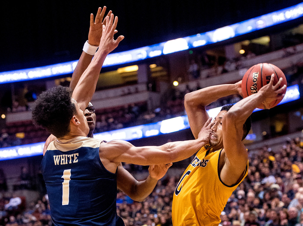. UC Irvine guard Jaron Martin, right, is cornered by UC Davis guard Lawrence White in the first half of the Big West Tournament Championship game in Anaheim on Saturday, March 11, 2017. (Photo by Paul Rodriguez, Orange County Register/SCNG)