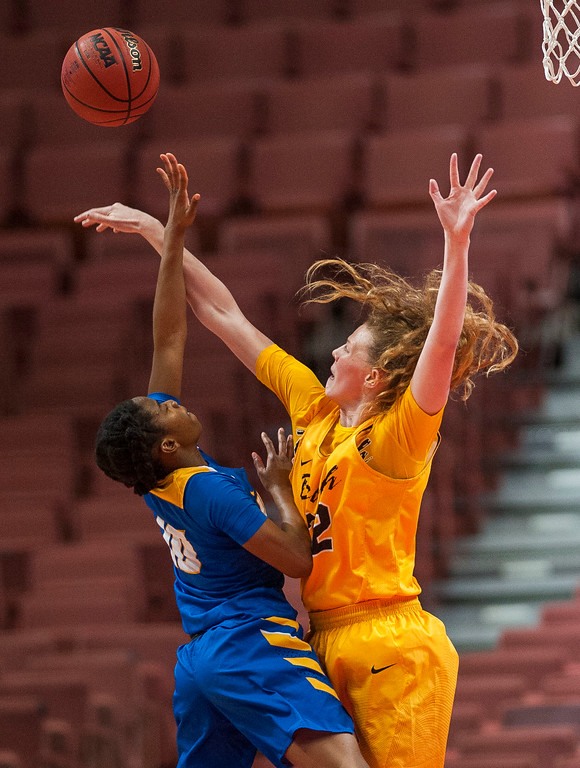 . Long Beach State forward Madison Montgomery, right, blocks a shot by UC Santa Barbara guard Onome Jemerigbe in the final of the Big West Women\'s Tournament in Anaheim on Saturday, March 11, 2017. (Photo by Paul Rodriguez, Orange County Register/SCNG)
