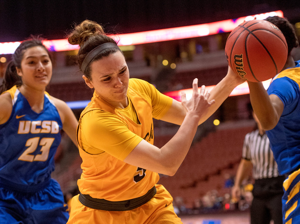 . Long Beach State guard Gigi Hascheff reaches to keep the ball in bounds during the Big West Women\'s Tournament final agaisnt UC Santa Barbara in Anaheim on Saturday, March 11, 2017. (Photo by Paul Rodriguez, Orange County Register/SCNG)