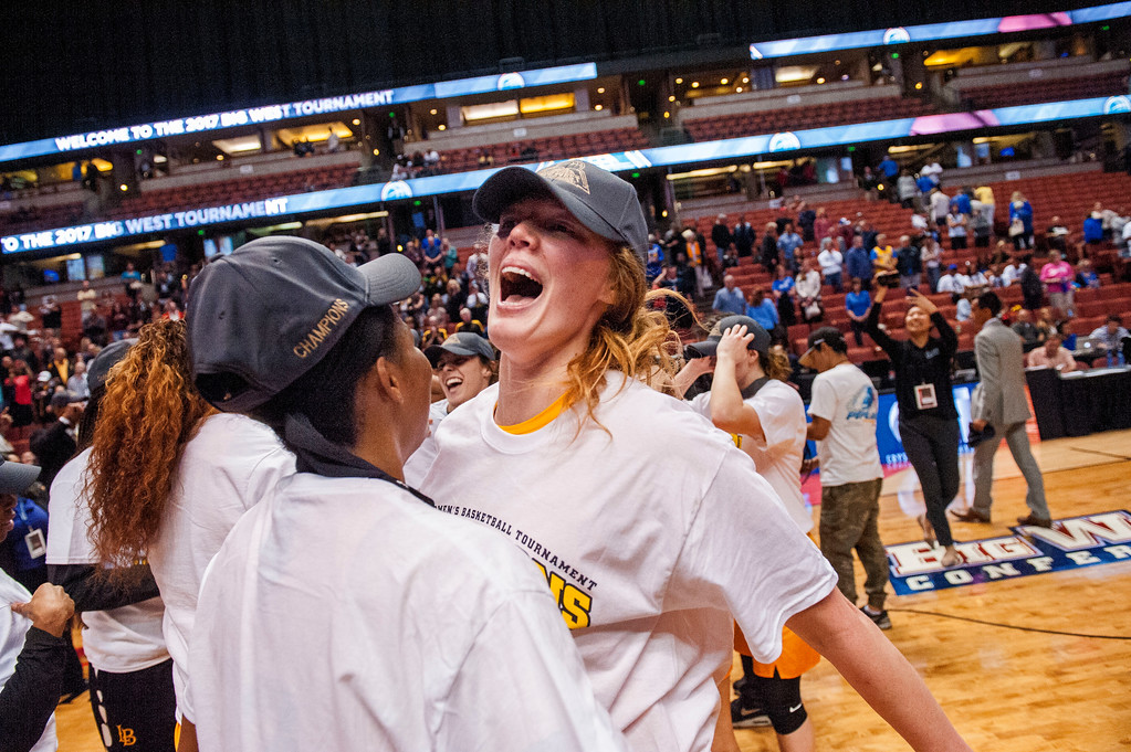 . Long Beach State forward Madison Montgomery, right, celebrates the Big West Women\'s Tournament Championship with a teammate in Anaheim on Saturday, March 11, 2017. (Photo by Paul Rodriguez, Orange County Register/SCNG)